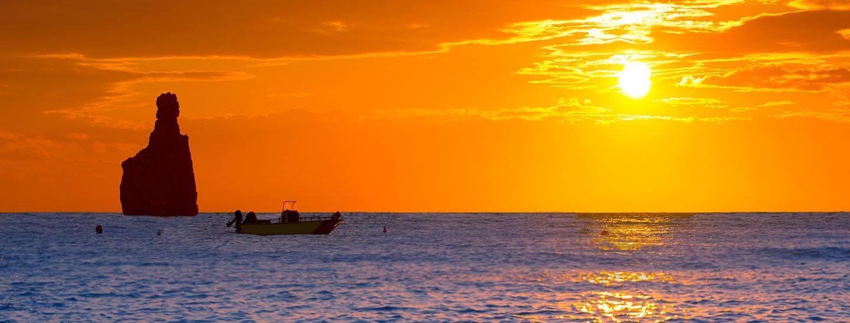 Ibiza Cala Benirras sunset beach in san Juan at Balearic Islands